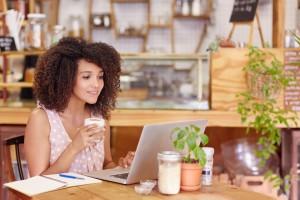 Millennial working freelance in coffee shop